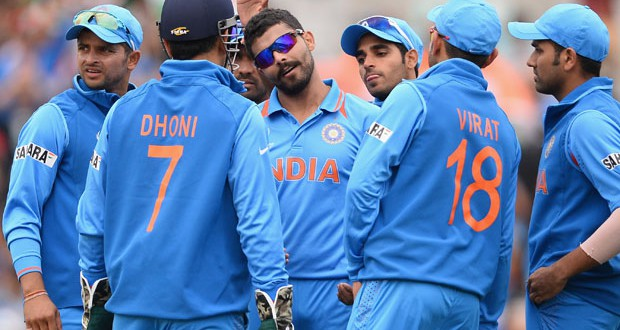 LONDON, ENGLAND - JUNE 11:  Ravrinda Jadeja of India is centre of attention after dismissing Ramnardiesesh Sarwan of West In during the ICC Champions Trophy Group B match between India and West Indies  at The Kia Oval on June 11, 2013 in London, England.  (Photo by Mike Hewitt/Getty Images)