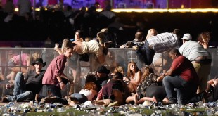 44F40D4700000578-4939872-People_scramble_over_barriers_to_get_to_safety_as_the_gunfire_ra-a-13_1506938197048