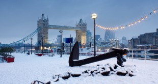 Early morning image of Tower bridge in snowfall.