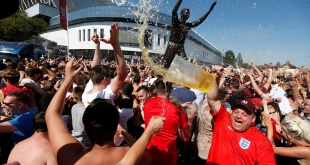 England fans in Bristol's Ashton Gate Stadium hurl beer in the air the moment Deli Alli scores England's second goal
