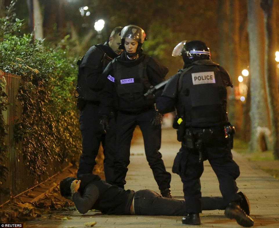2E6CF2F700000578-3317776-A_man_lies_on_the_ground_as_French_police_check_his_identity_nea-m-50_1447461215203