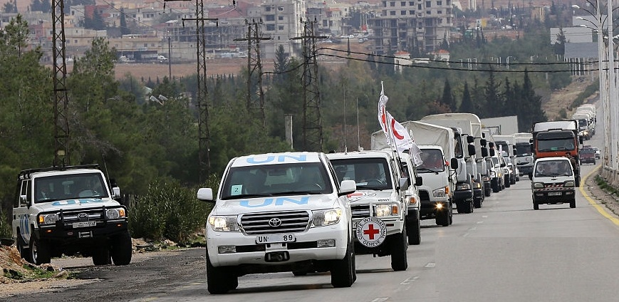 aid-convoys-carrying-food-medicine-and-blankets-leave-the-syrian-as-picture-id504504604