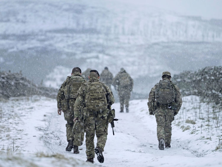 Soldiers go out on exercise near Stainmore on the Durham and Cumbria border during a snow blizzard as freezing weather grips the UK and heavy snowfall has led to travel disruption.